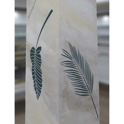 Palm frond stencils on column