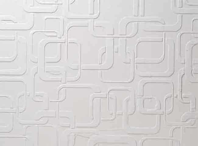 motif au pochoir rétro dans un plâtre de marbre blanc